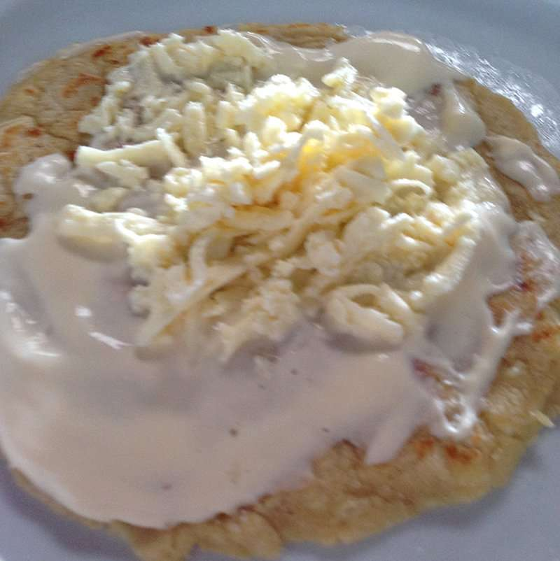 homemade tortilla with sour cream and queso