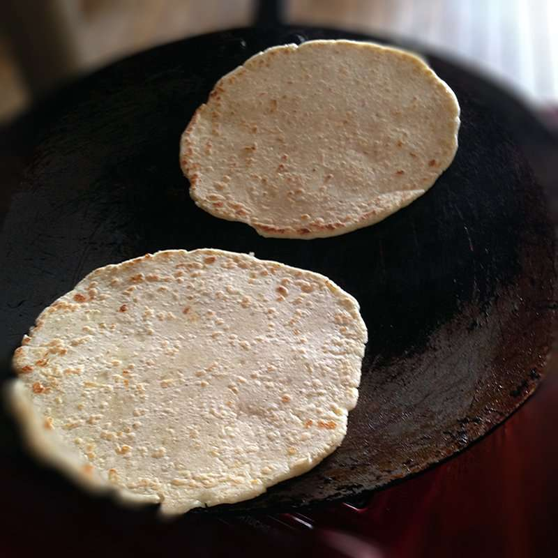 homemade tortillas on the griddle