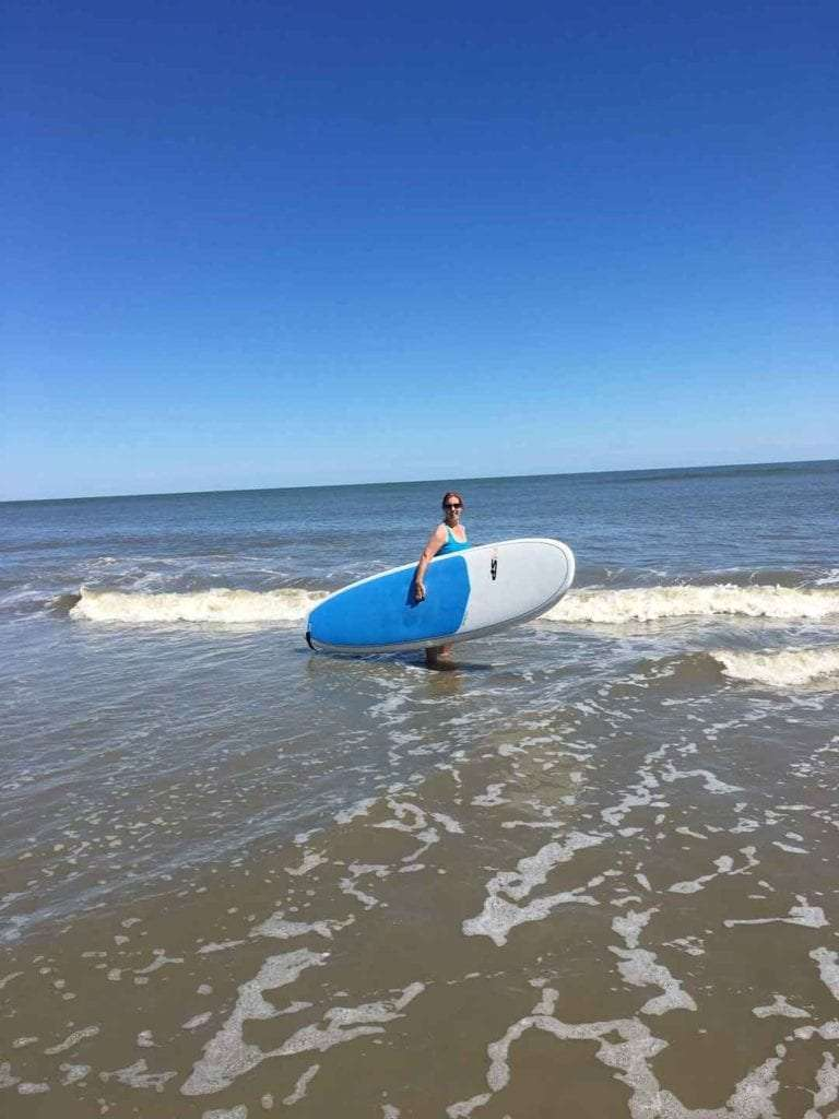 This mom did some paddleboarding when she did solo travel