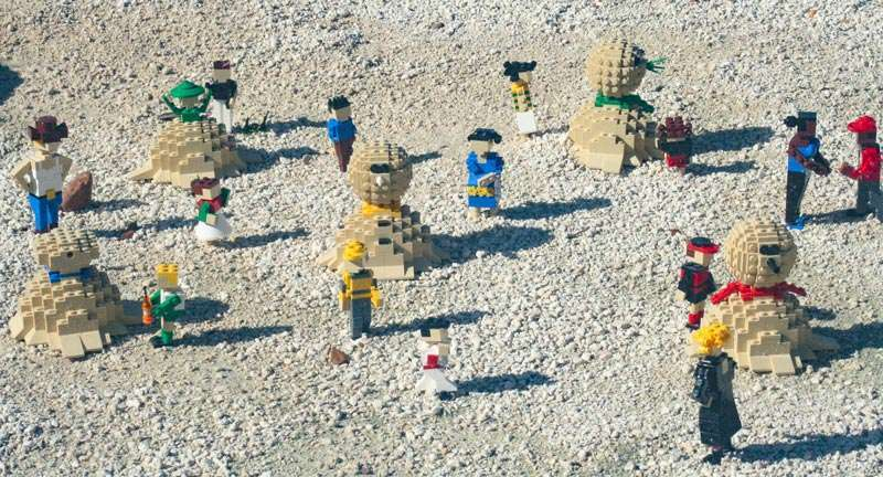 Christmas Events in Florida Legos building snowen in the sand