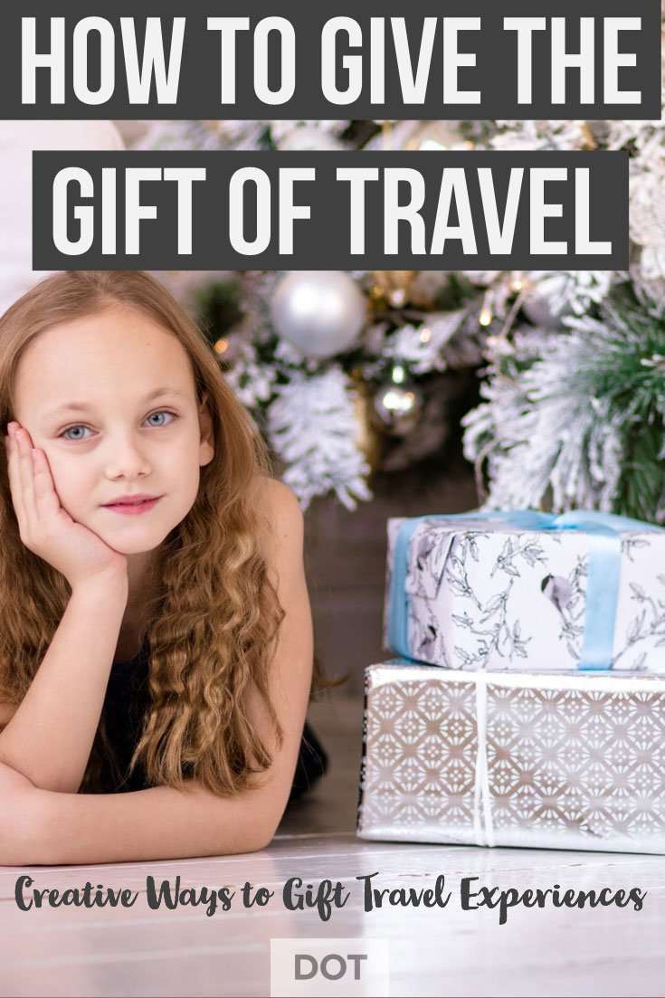 How to Gift the Gift of Travel young girl under tree with presents