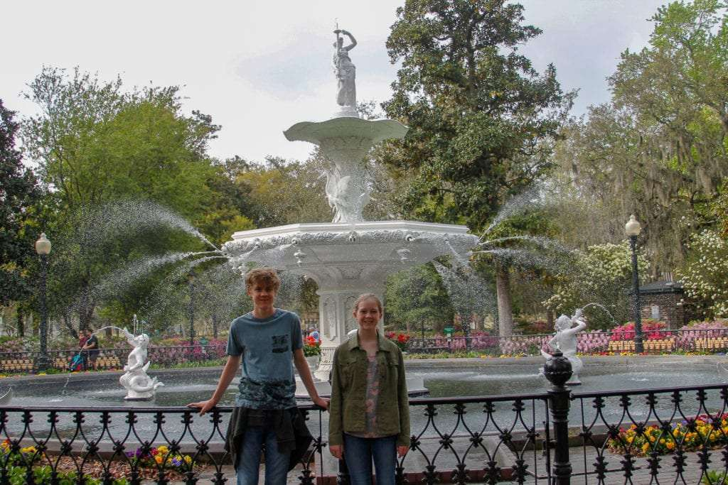 Things to Do with Teens in Savannah. Forsyth Park Fountain with teen boy and teen girl.