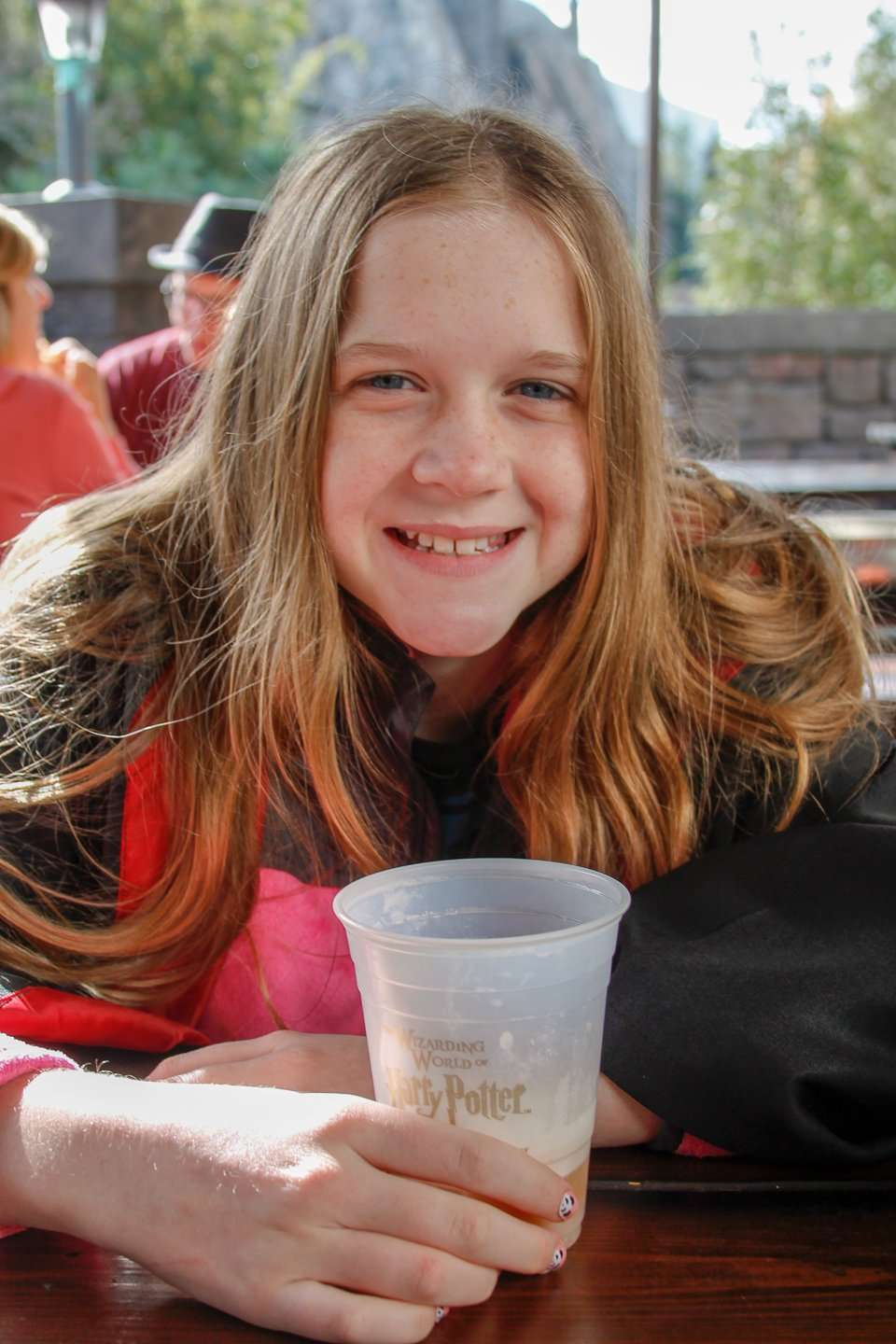 girl drinking Butterbeer