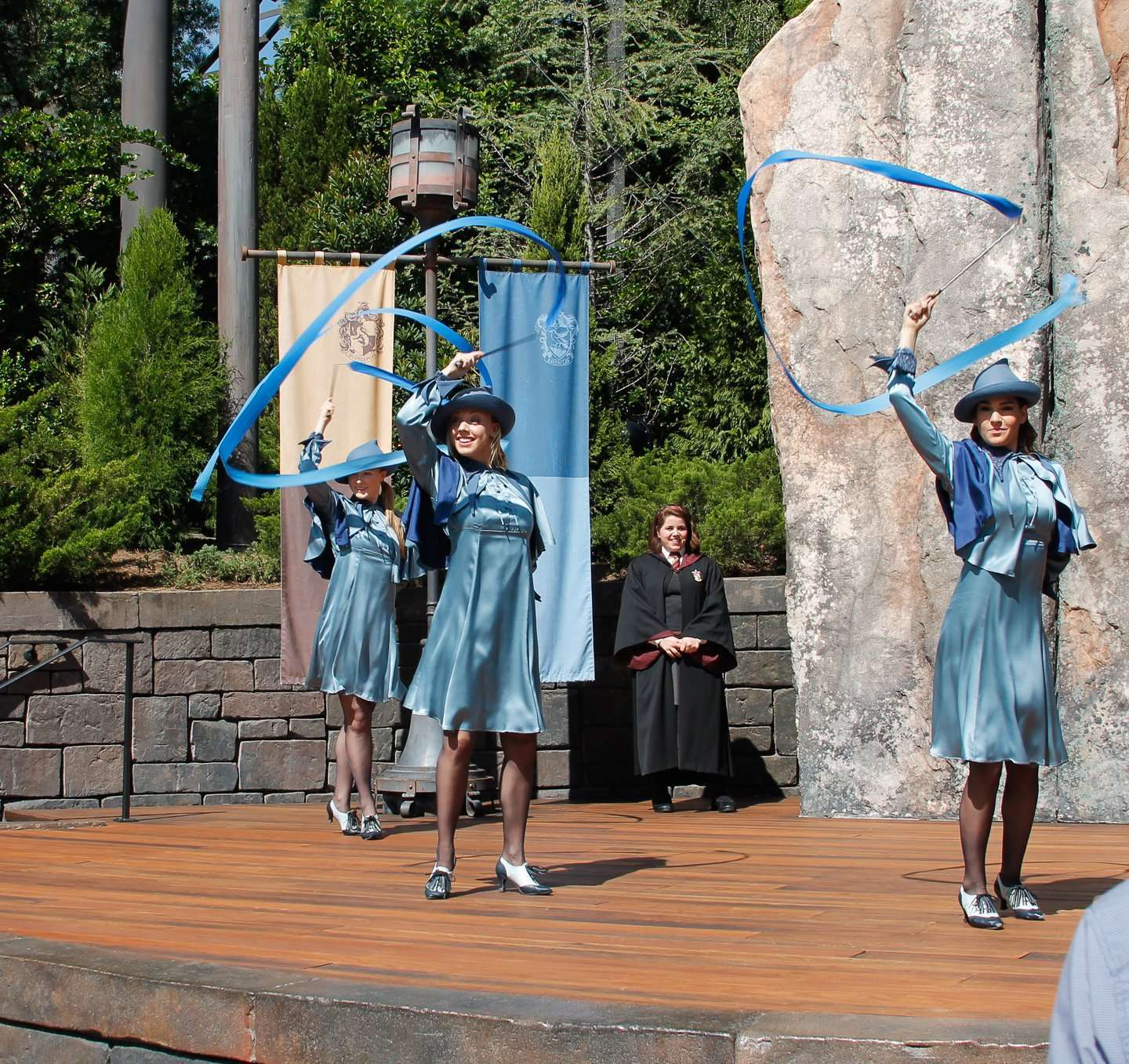 Everything about the Wizarding World of Harry Potter Beauxbatons girls waving banners