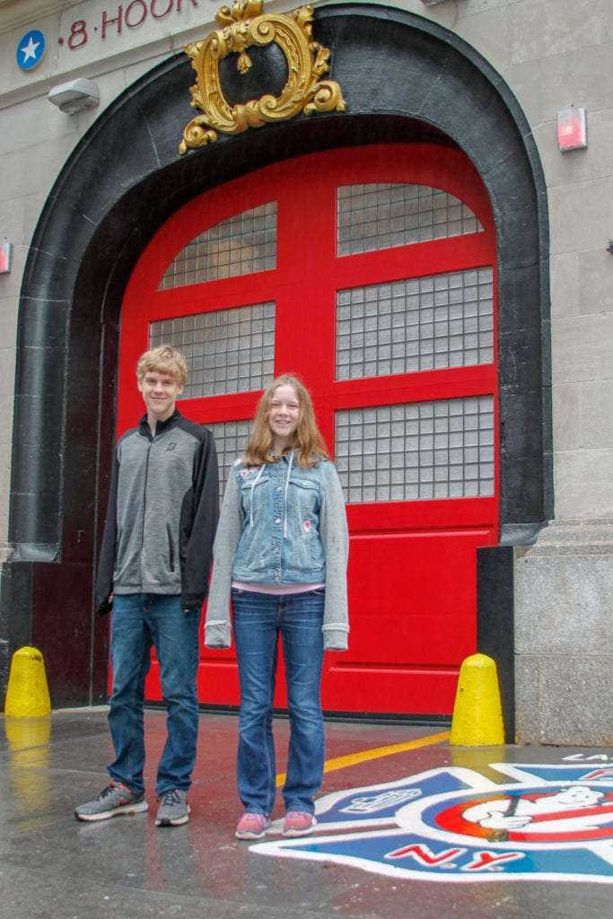 Movie and TV Locations in NYC hook and Ladder 8 from Ghostbusters with boy and girl standing in front