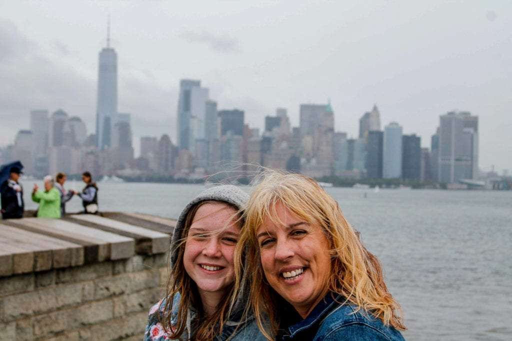 Visit the Statue of Liberty view of harbor with mom and daughter