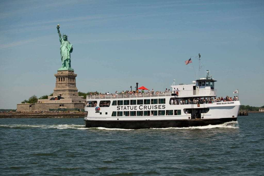 Visit the Statue of Liberty Close up view of Statue with Statue Cruise ferry boat