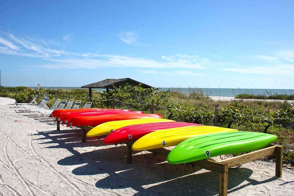Kayaks and paddleboards for rent on beachfront hotel Sanibel Island