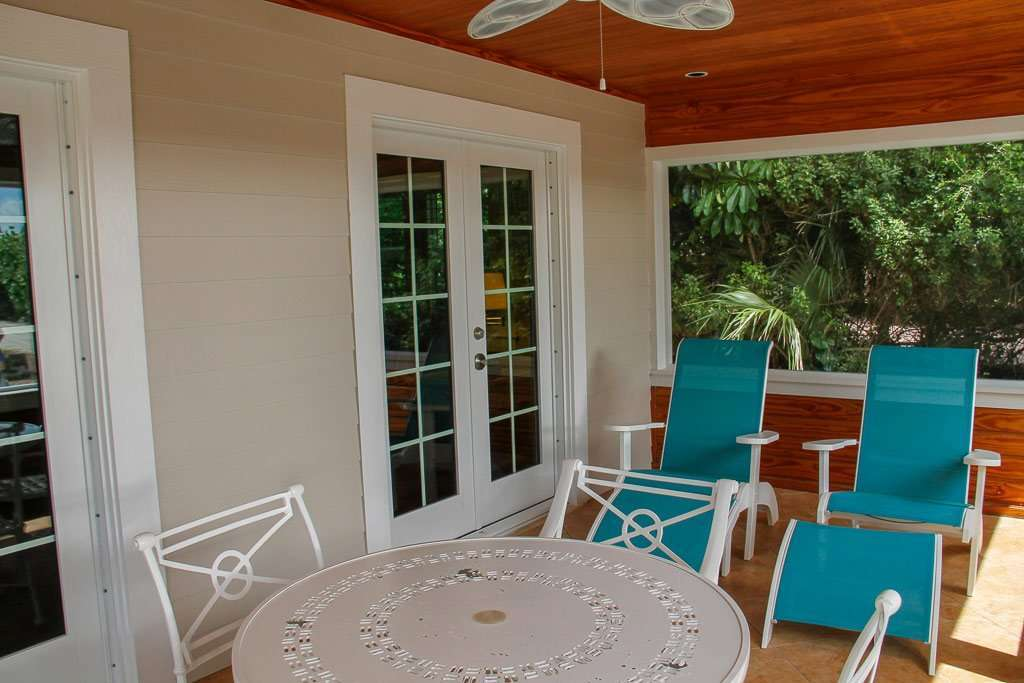 Beachfront Hotel Sanibel Island screened in porch on cottage
