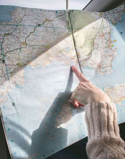 Why Road Trips are Better than Flying girl in car with map