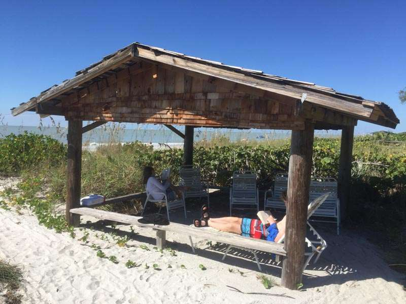 Kids relaxing in cabana on Sanibel Island Beach one of the best places to travel with kids