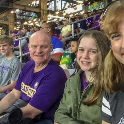 women girl man boy family in Orlando City Soccer Stadium sporting events travel