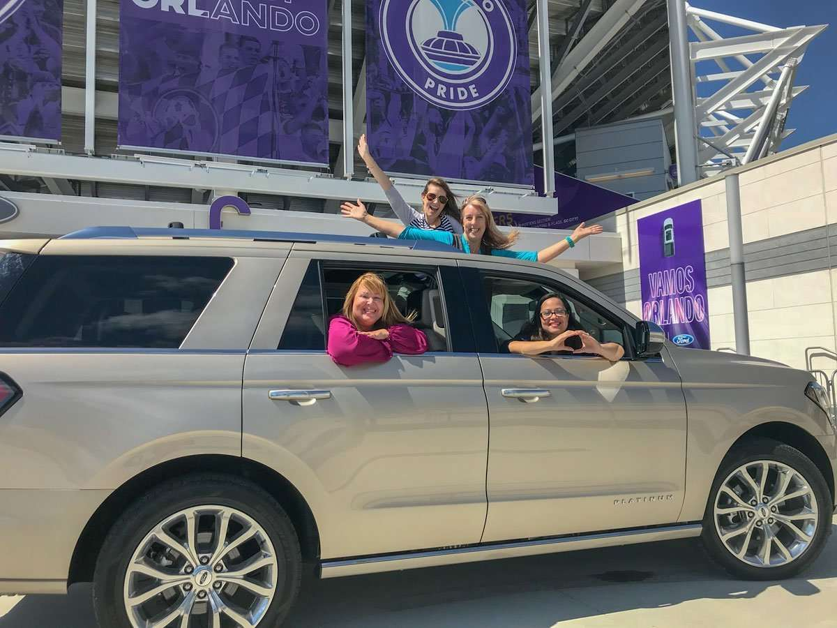 Women in Ford Expedition in front of Orlando City Stadium for sporitng events travel