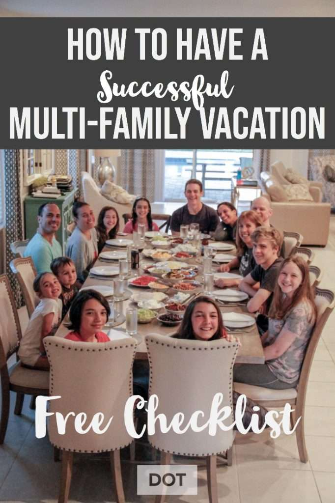 large family group around a dining table for a multifamily vacation