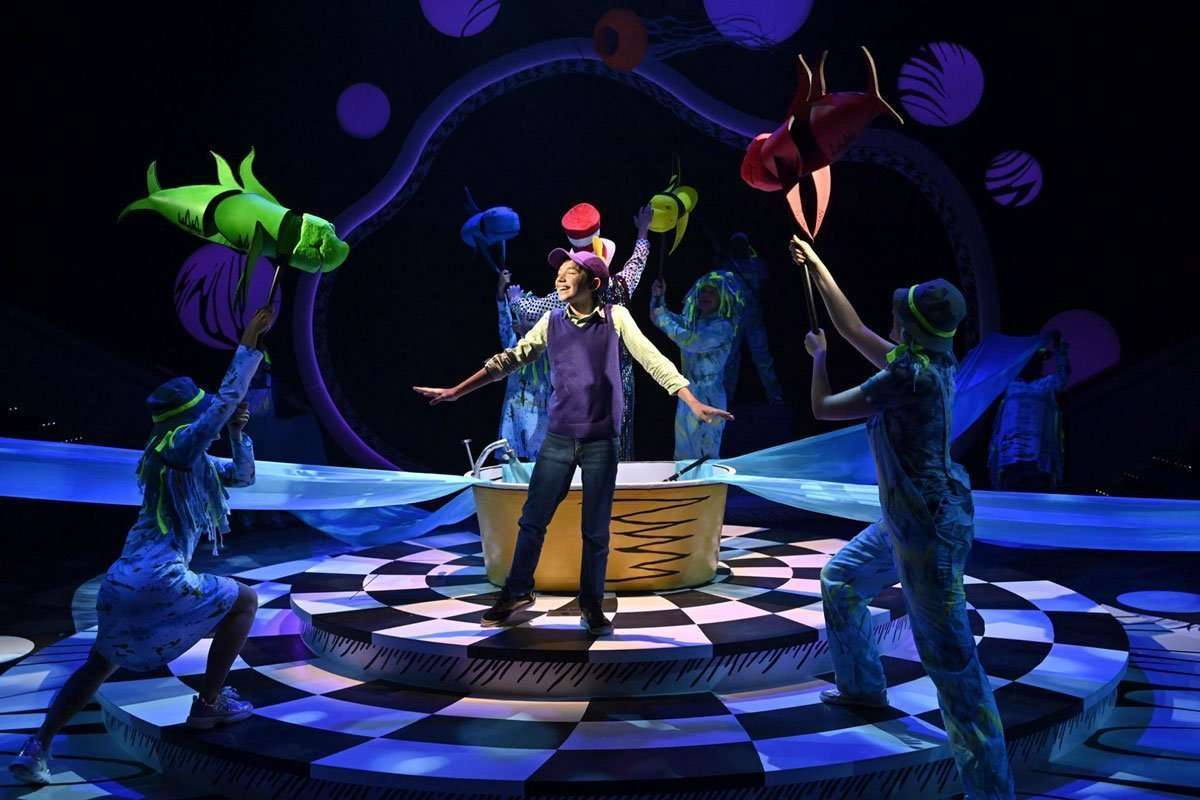 Seussical the Musical playing at the Orlando Rep. boy singing with dancers
