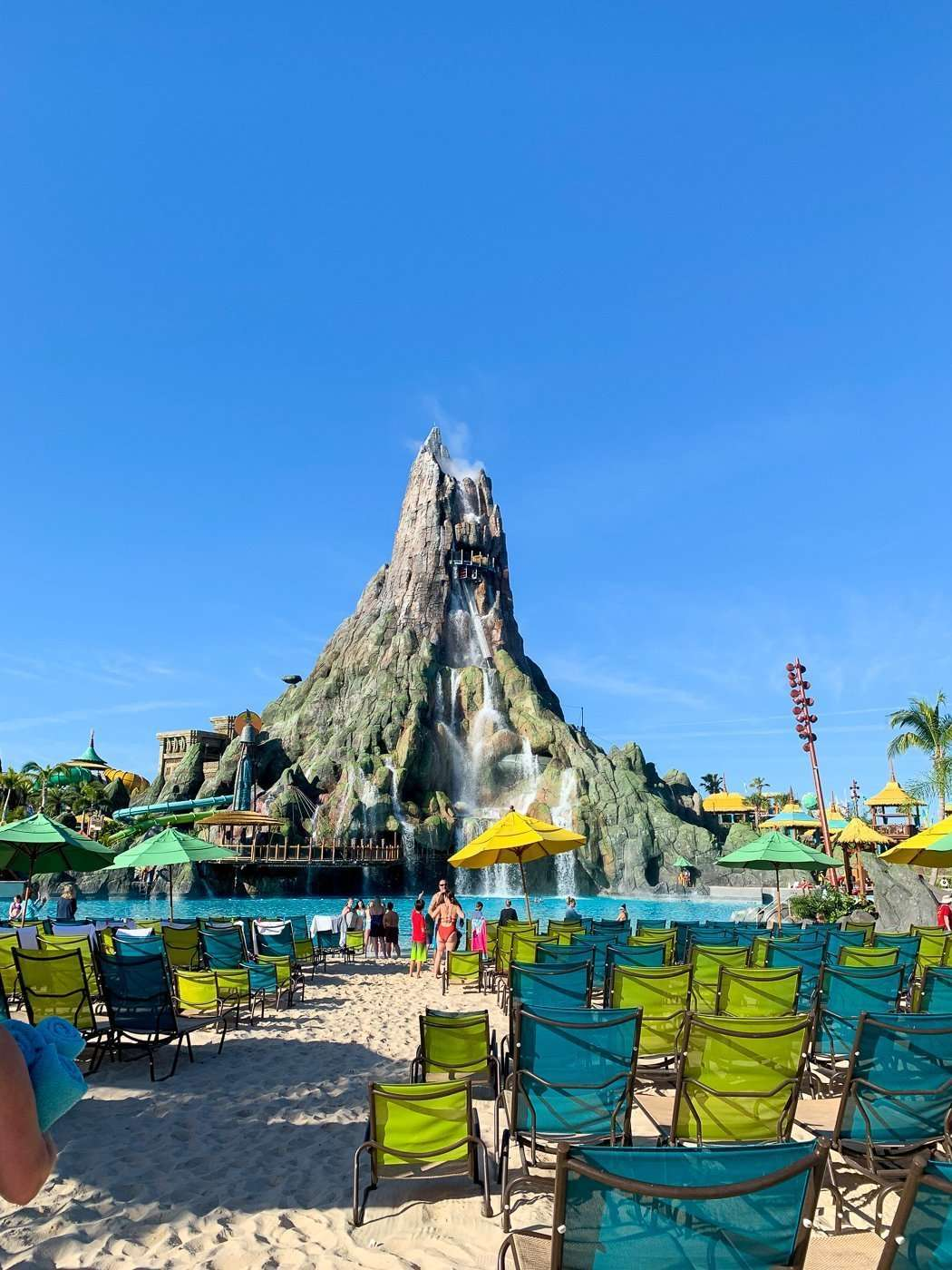The Best Family Water Park is Volcano Bay at Universal Orlando picture of volcano and beach chairs