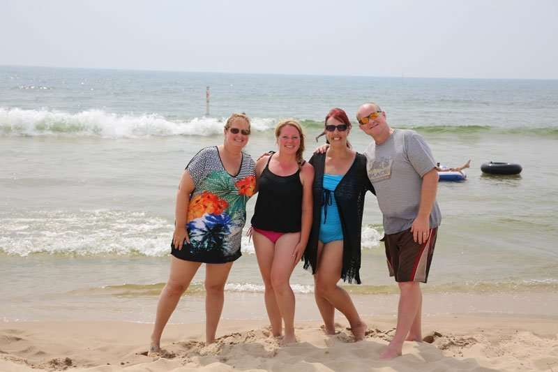 adults on a beach for the best multifamily vacation destination