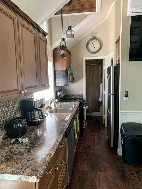 kitchen area inside of cabin with hall at Crystal Isles RV Resort