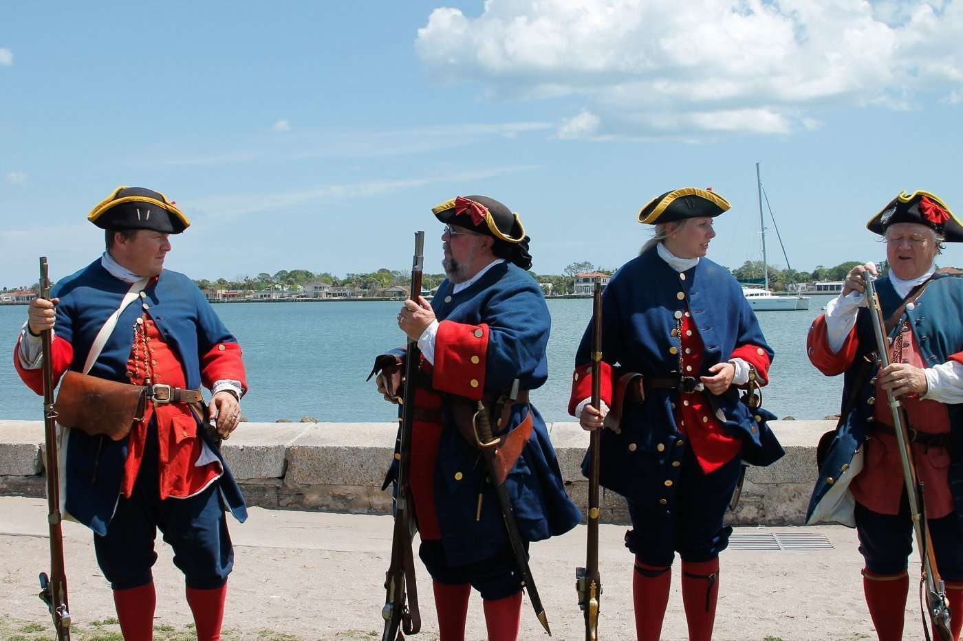 soldiers demonstrating musket shootings in a historical reenactment as part of St. Augustine's living history