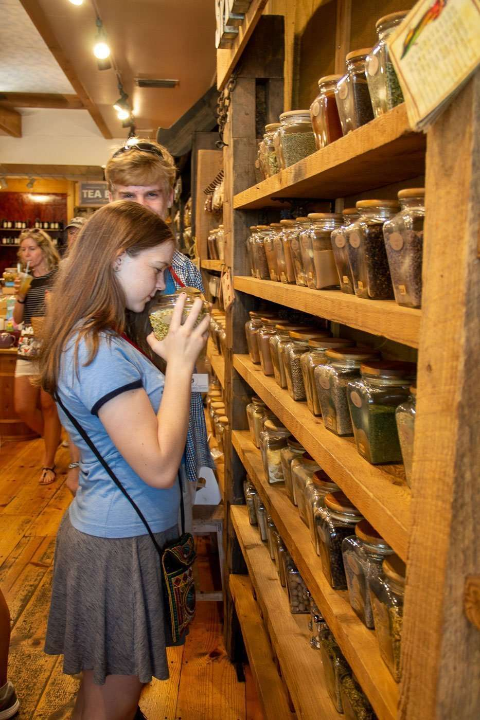 girl smelling spices at a culinary tour thigns to do with teens in sarasota