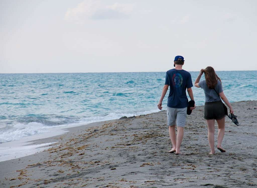 two teenagers walking the beach in Venice Beach Florida things to do with teens in Sarasota