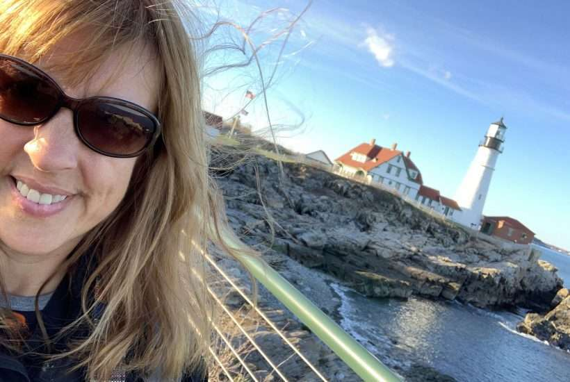 Get the Best of Portland with these tips on how to spend 24 hours in Portland Maine. Woman in front of Portland Head Lighthouse