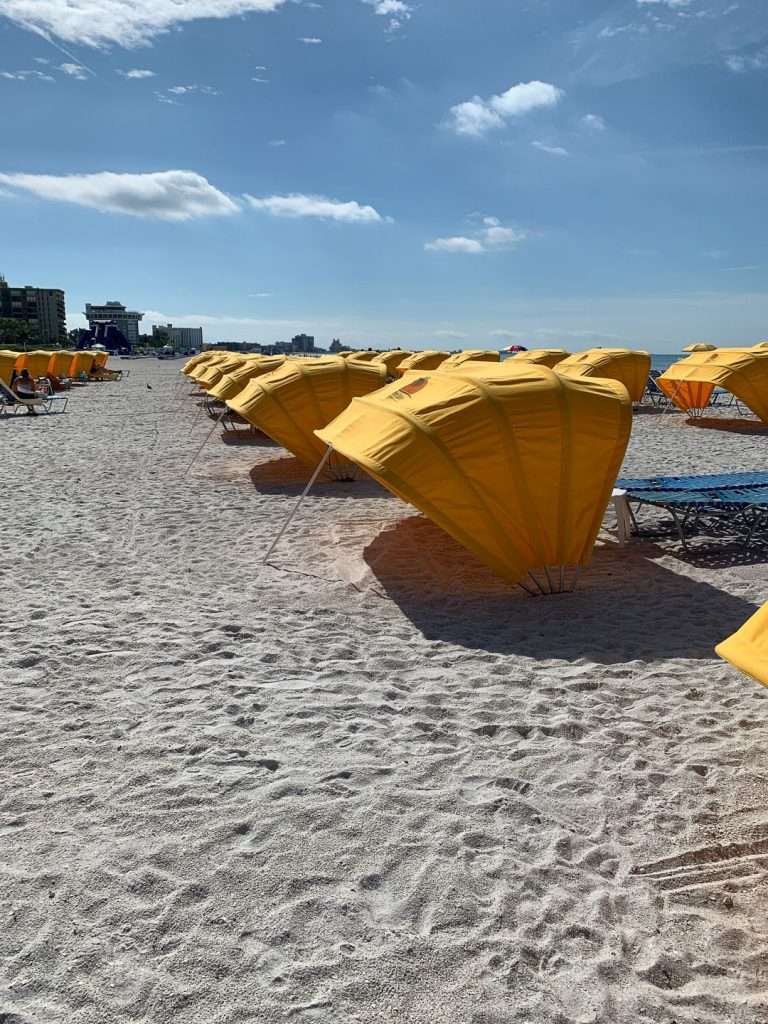 Alden Suites yellow cabana umbrellas on sandy St. Pete Beach