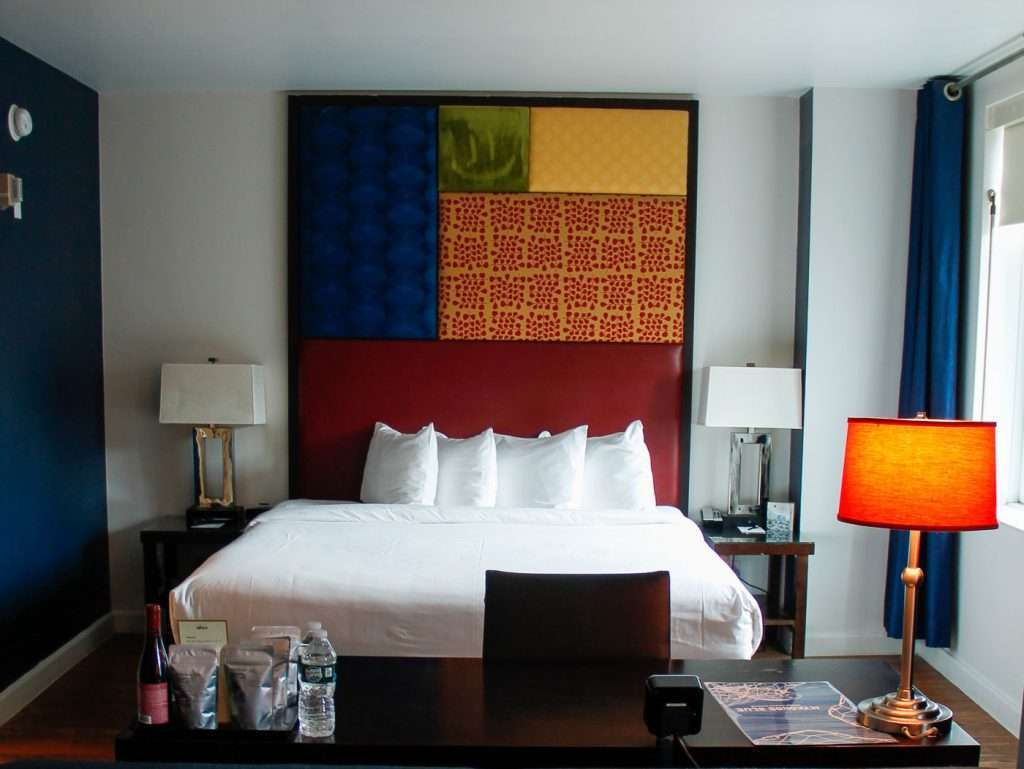 How to save money on vacation a hotel room with vibrant painting