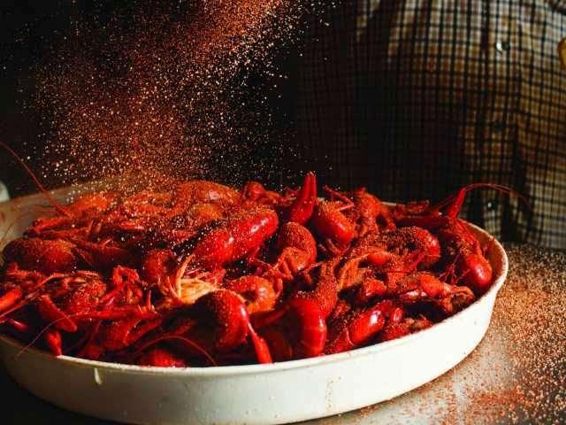 bowl of crawfish with seasoning