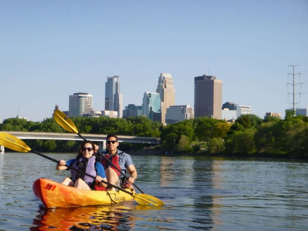 couple in kayak outside of Minneapolis, Minnesota, one of our picks for cheap destinations