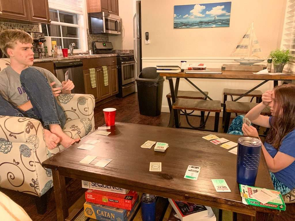 2 kids playing family travel card games