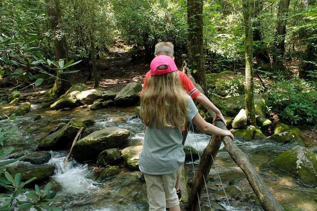 kids walking path in mountains
