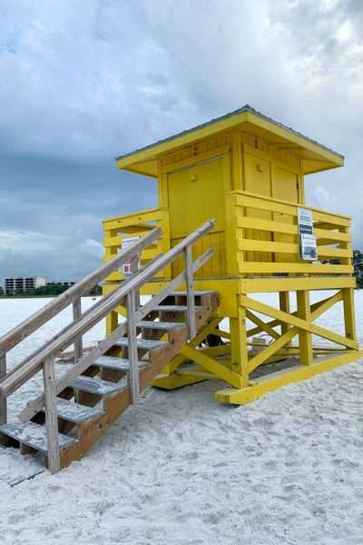 yellow lifeguard shack on white sand Florida Beaches