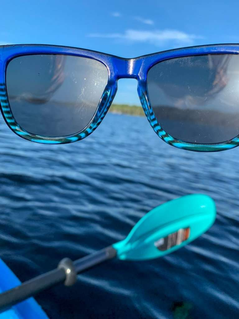 image of Knockaround polarized sunglasses and water, one of the things to bring on a kayak.