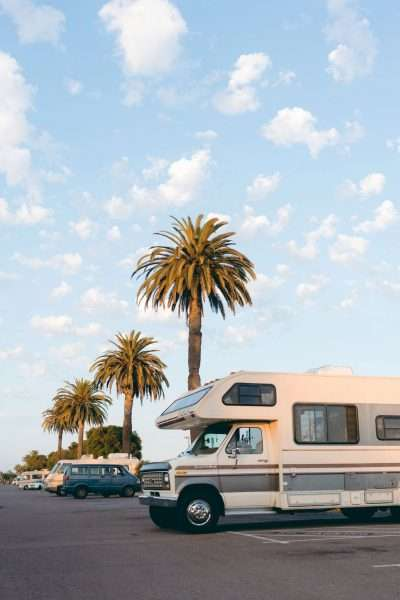 keeping RV Safety while camping with an RV and palm trees