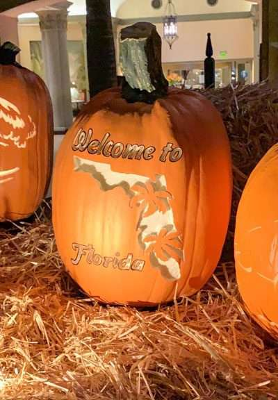 carved pumpkins lit on a bail of hay for halloween in orlando