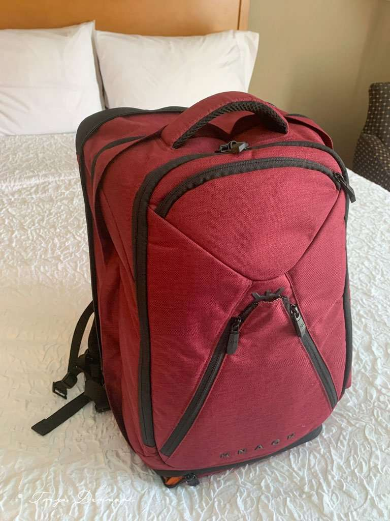 Knack Pack brand backpack with lots of compartments perfect for travel while working remotely