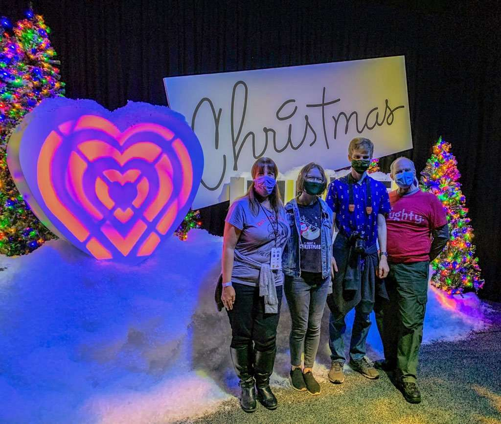 Family in front of I Love Chfistmas Movies Sign at Christmas at Gaylord Palms