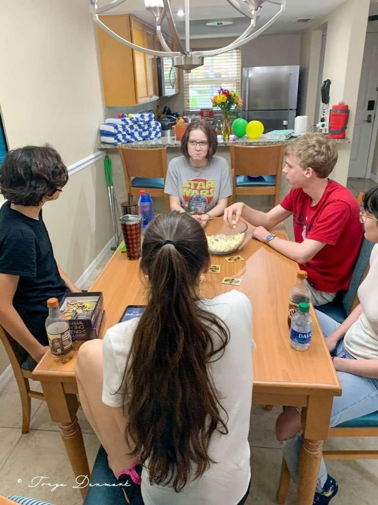 kids around table playing games at Fantasy World Resort