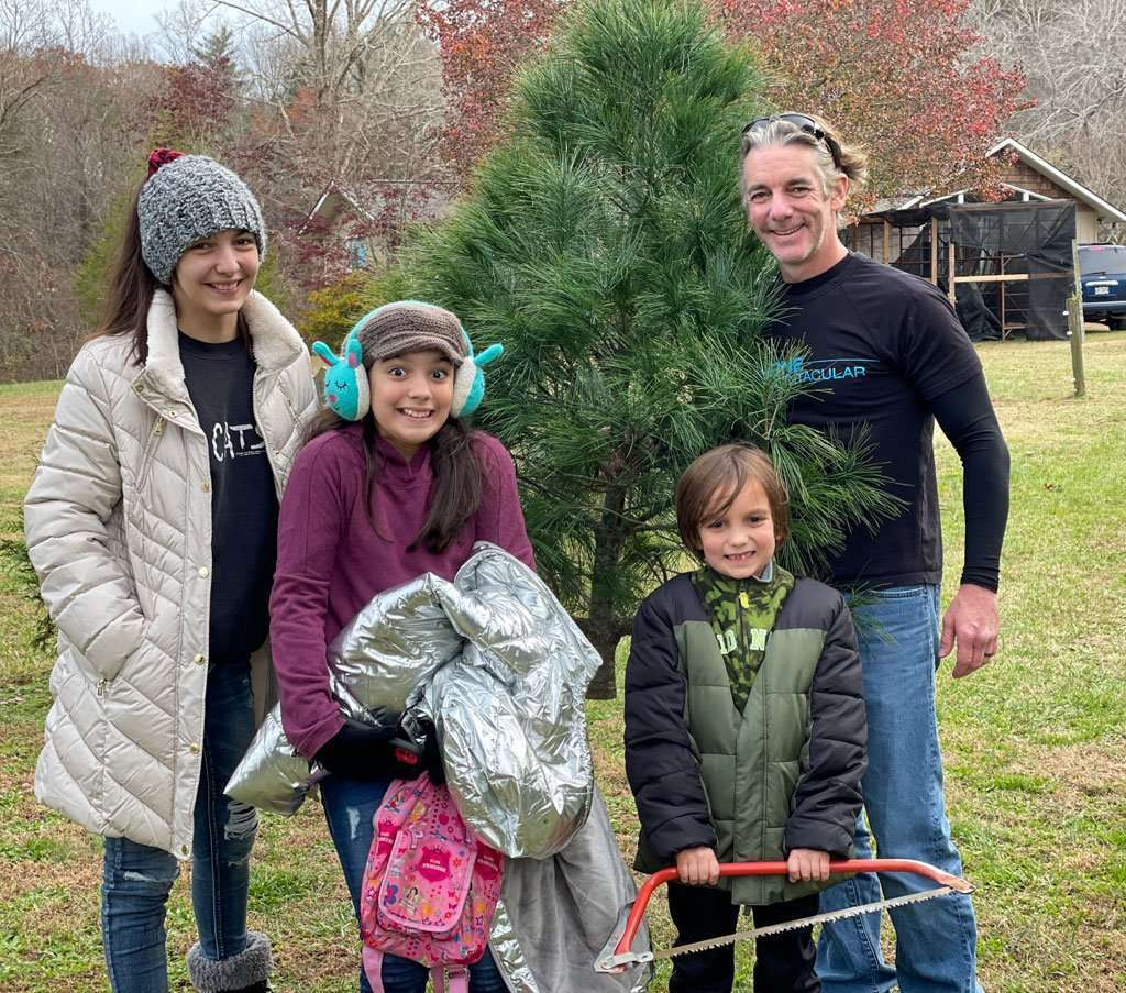 Family with fresh cut Christmas tree