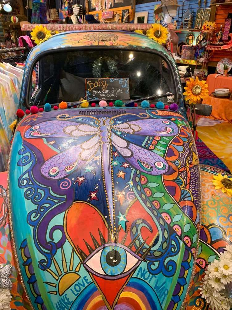 Brightly painted VW beetle with sunflowers