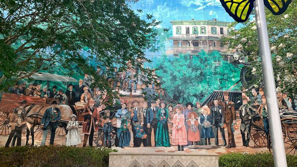 Historic mural in downtown DeLand, Florida depicting settlers of DeLand